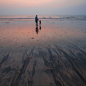 Banter, bonding on the beach. by Shikhar Sharma - Landscapes Sunsets & Sunrises