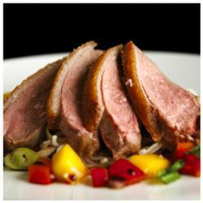 Roast duck breasts with a Vietnamese noodle and mango salad