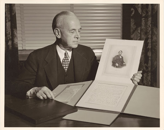Photograph of Cornell President Edmund Ezra Day with Cornell's copy of the Gettysburg Address [Cornell University, Ithaca, N.Y., ca.1949].