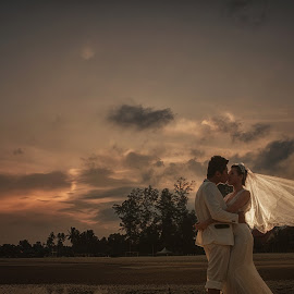 Love Kiss by Tim Chong - Wedding Bride & Groom