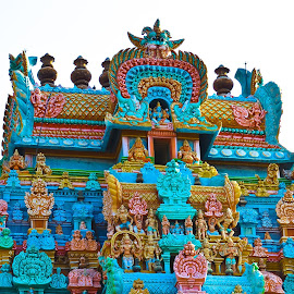 Srirangam Temple Gopuram by Ivon Murugesan - Buildings & Architecture Places of Worship ( orange, god, green, colors, yellow, goddess, tamil, colours, temple, colour, hindu, red, sky blue, blue, color, indian temple, hindu temple, india, gopuram, srirangam, tamilnadu )