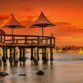 Just Fishin' by Alex Stecina - Buildings & Architecture Other Exteriors ( water, clouds, sky, sunset, boats, beach, jetty, fishing, drama, rocks, colours )