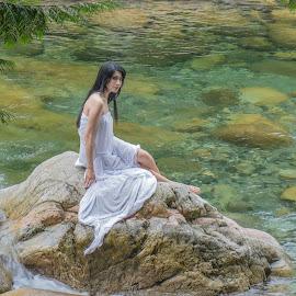 Stolen moment by Eva Krejci - People Street & Candids ( girl model, white gown, gark hair, rocks, river )