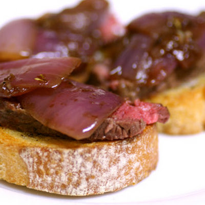 Bistecca with Balsamic-Roasted Onion Crostini