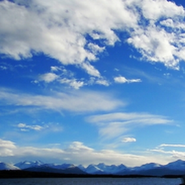 Above the mountains by Vladimir Kovalenko - Landscapes Travel ( mountain, lighthouse, sea, landscape, spring, sun, fjord, norway, lantern, sky, blue, weather, cloud, light, daylight )