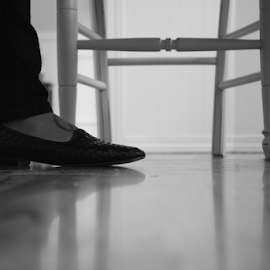 flat foot. by Henk Holveck - People Body Parts ( chair, hard wood, floor, black and white, flat, perspective, tattoo, shoe )