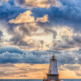 Storm Breaks Up by Charles Anderson Jr - Landscapes Weather ( water, lighthouse, pier, storm, sun )