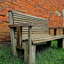 Waiting by Barbara Brock - Buildings & Architecture Other Exteriors ( red brick building, antique bench, old bench, wooden bench )