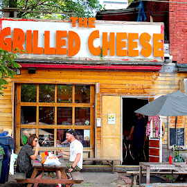 The Grilled Cheese by Ronnie Caplan - City,  Street & Park  Neighborhoods ( streetscene, window, wood, patio, signage, restaurant, people )