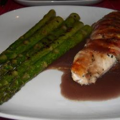Bacon Wrapped Chicken And Grilled Asparagus With Red Onion And Mushroom Gravy