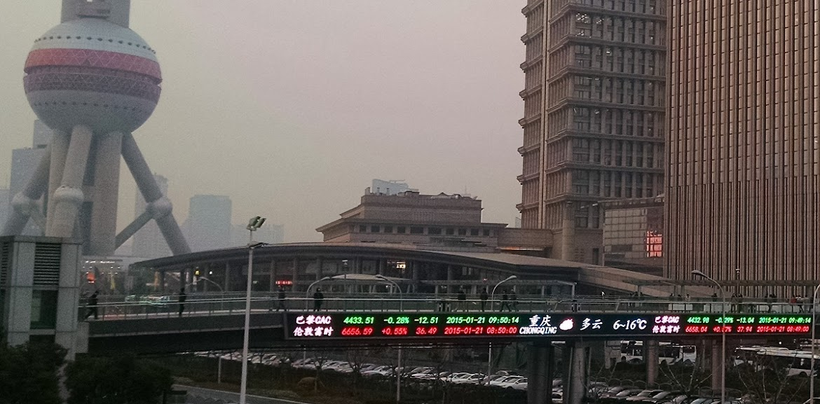 View of stock tickers in the Shanghai financial district January 2015