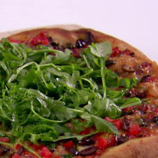 Puttanesca Pizza with Taleggio and Arugula