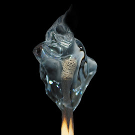 water match by Desmond Torrez - Digital Art Things ( water flame match edit digital photography )