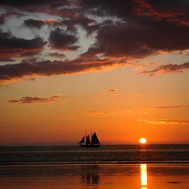 Sailboat in a Broome sunset by Mick McKean - Landscapes Sunsets & Sunrises ( tod, reflection, time of day, broome, silhouette, boats, ocean, sailboat, boat, landscape, vessels, cable beach, sun, into sun, sunset, australia, sundown, western australia, Beach, blue, water, ocean.  )
