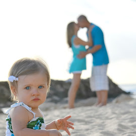 Mommy and daddy are kissing!!! by Marissa Frederick - People Family ( dad, girl, todder, daughter, beach, baby, oahu, hawaii, mom )