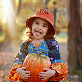 Silly Pumpkin by Darya Morreale - Babies & Children Child Portraits ( girl, fall colors, autumn, pumpkin, forest )
