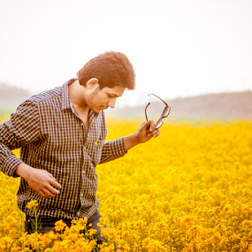 Yellow Man by Jatin Malhotra - People Portraits of Men ( nature, men, yellow, flowers, portrait )