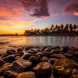 Falling Flame by Ade Noverzan - Landscapes Waterscapes ( sunset, beach, stones, dusk )