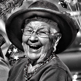 Happy face by Gaylord Mink - Black & White Portraits & People ( parade, maturity, laugh, woman, portrait,  )