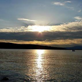 Lone Boat on Gently Gilt Eve by Nat Bolfan-Stosic - Landscapes Sunsets & Sunrises ( eve, gilt, sunset, gently, boat,  )