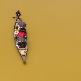 Boat ride through mud water by Istiak Saikot - Transportation Boats ( ride, water, mud, umbrella, journey, boat, people, waterway )