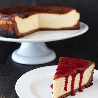 New York Style Cheesecake with Raspberry Sauce