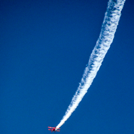 Speeding downward by Kati Garner - News & Events Entertainment ( blue sky, airplane, entertain, contrail, airshow )