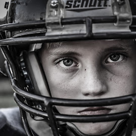 Dedication by Angela Sweeney Sellards - Sports & Fitness American and Canadian football ( youth football, player, football, black and white, dedication, determination, focus, son, youth,  )
