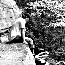 Looking Down by Charles Shope - People Portraits of Men ( person, natual light, nature, black and white, cliff, hocking hills, leaves, boy, man )