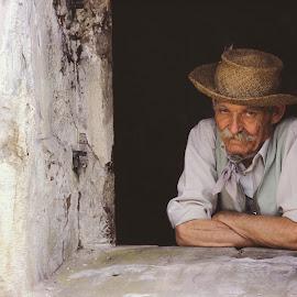 Man in window  by Paul Wyman - People Portraits of Men ( old, window, male, man, portrait )