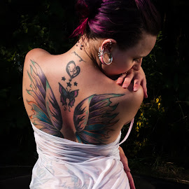 by James Baker - People Body Art/Tattoos ( water, person, model, purple, piercing, body art, behind, people, farm, bathing, tattoos, goth, tub, trees, wet, transparent, tattoo, outside )