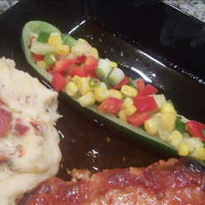 Corn and Bell Peppers Stuffed Zucchini