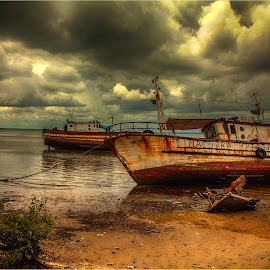storm clouds by Maricha Knight van Heerden - Transportation Boats ( clouds, the macurba, moored, low tide, seascape, fishing vessel )