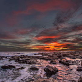 Dragons Breath by Clive Wright - Landscapes Sunsets & Sunrises ( sea, rock, landscape )