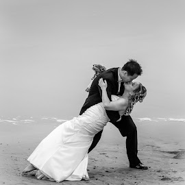 On the beach by Paul Brown Jr. - Wedding Bride & Groom