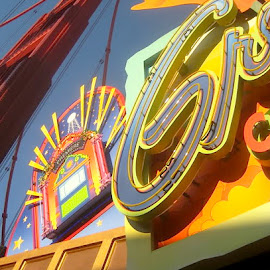 Disney Signs by Ronnie Caplan - City,  Street & Park  Amusement Parks ( signs, sky, colourful, bright, shadow, neon, los angeles, disneyland, crane )