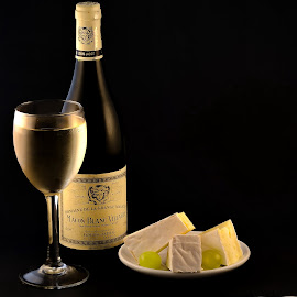 a piece of cheese  by Bela Paszti - Food & Drink Alcohol & Drinks ( wine, food, grape, white, d7000, cheese, whie wine, bottle )