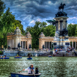 Sunday afternoon by Marco Pisi - City,  Street & Park  City Parks ( clouds, water, calm, europe, rowing, relax, madrid, grandfather, lake, boat, people, spain, tranquil, statue, sky, retiro, trees, monument )