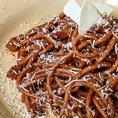 DRUNKEN BUCATINI (traditional thicker spaghetti) with red wine sauce and guanciale