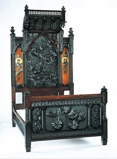 Benn Pitman was a teacher of woodcarving at the Art Academy of Cincinnati. He was the designer of this bedstead, but his wife, Agnes Nourse Pitman did the carving. Her sister, Elizabeth Nourse painted the panels. Many of Pitman's students were women, fostering the role of women in the decorative arts which extended into art pottery (such as Rookwood Pottery).