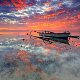 Burning Sky over the Boat by Sunan Tara - Transportation Boats ( bali, karang beach, waves, sanur, twilight, rock, beach, seascape, landscape, dusk, sun, sunset, wave, sunrise, rocks )