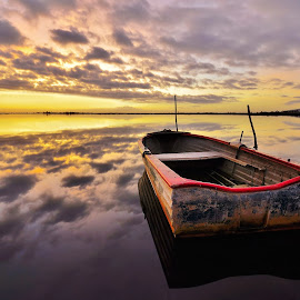the boat at dawn by Daniele Dessì - Transportation Boats
