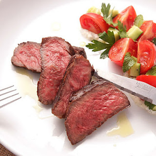 Grilled Strip Steak with Creamy Yogurt Sauce and Tomato-Cucumber Salad