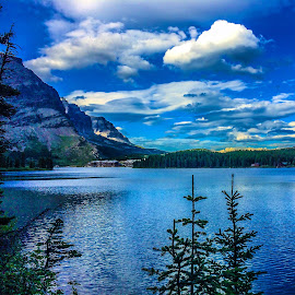 Swiftcurrent lake  by Rick Theis - Landscapes Waterscapes ( glacier park )