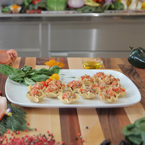 Red Pepper Pesto Bruschetta with Fresh Parmesan in Tostitos® Scoops!