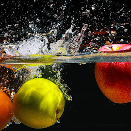 Splash with Colors by Nauman Khan - Food & Drink Fruits & Vegetables ( water, bubble, orange, red, splash, green, colors, apple, wave, splash water photography )