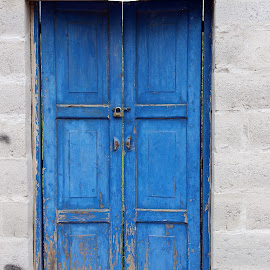 Blue Wooden Door by Robert Hamm - Buildings & Architecture Architectural Detail ( urban, ecuador, wood, blue, cotacachi, brick, outdoor, door, cement, concrete, entrance, wall )