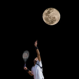 The Supermoon and the International Tennis Federation tournament were both themes today in Saskatoon, combined here with a photo of Fritz Wolmarans of South Africa, who advances to the finals tomorrow. by Gary Dobbin - Sports & Fitness Tennis