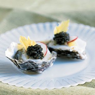 Oysters on the Half-Shell with Scallops, Horseradish, Lime and Golden Osetra Caviar