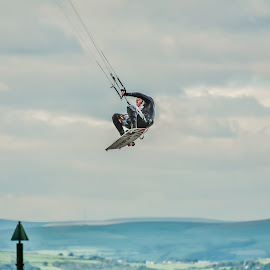 Flying by Janet Packham - Sports & Fitness Watersports ( water, flying, danger, kite surfing, sport )